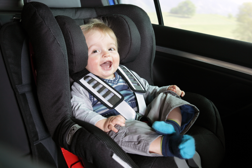 Baby boy in a child safety car seat